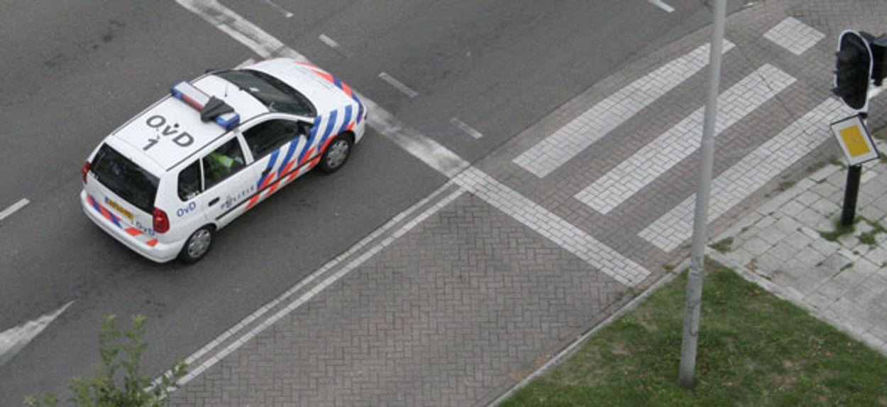 Afbeelding van Zelfremmende politiewagens terug naar garage