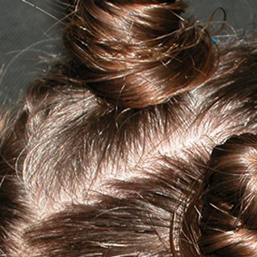 Afbeelding van Tip dermatologen: Doe je knot niet te strak mannen!